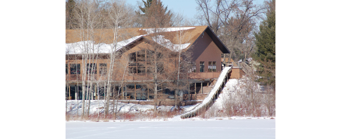 Spencer-Lake-commercial-architect_camp_Dining-Hall-exterior-view-winter-2-1100x450.jpg