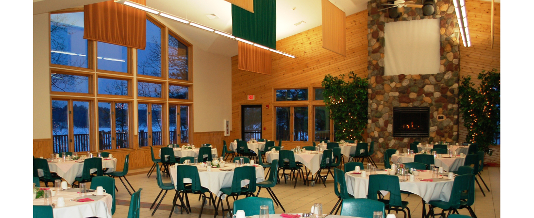 Spencer-Lake-commercial-architect_camp_Dining-Hall-interior-view-fireplace-2-1100x450.jpg