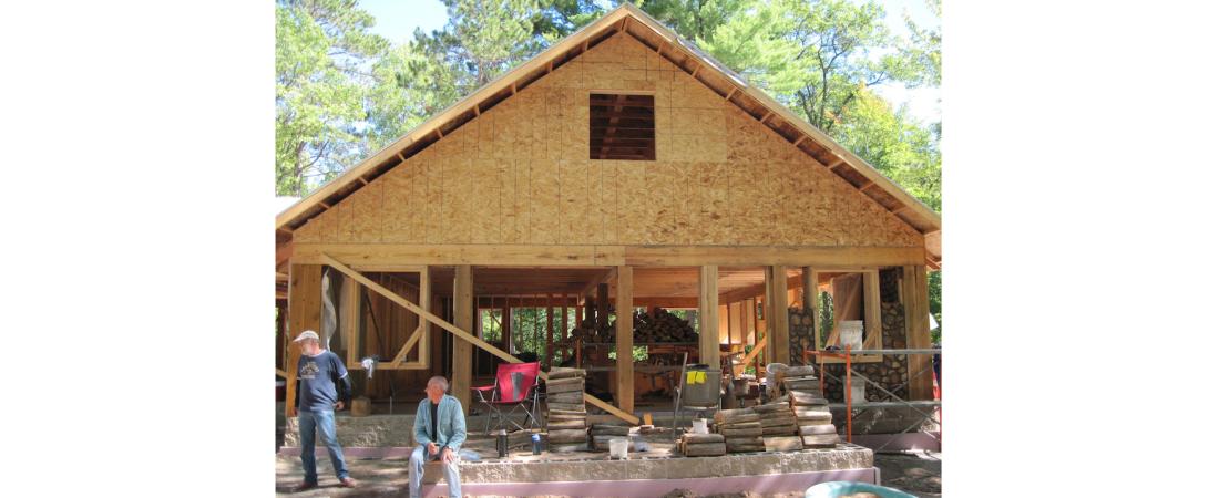 wisconsin-residential-architect_custom-home_cordwood_Exterior-Progress-View-1100x450.jpg