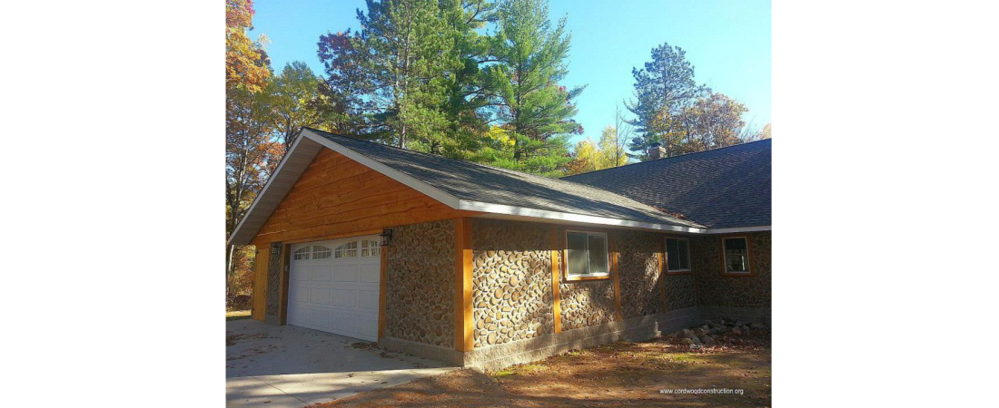 wisconsin-residential-architect_custom-home_cordwood_Exterior-View-2-1100x450.jpg